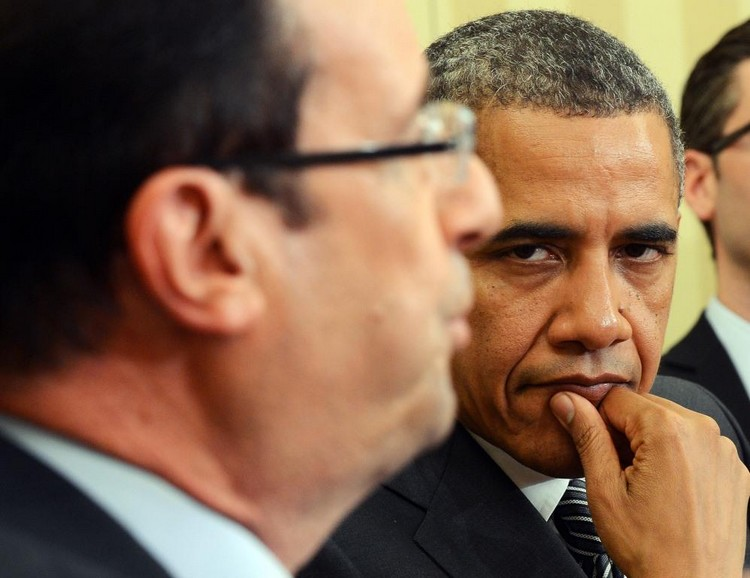 "US President Barack Obama (R) listens as French President Francois Hollande speaks following their bilateral meeting in the Oval Office at the White House in Washington, DC, on May 18, 2012 in advance of the G8 and NATO Summits. Obama told French counterpart Francois Hollande during White House talks on Friday that their countries' bilateral relationship is ""deeply valued"" by Americans. Just three days after being sworn in to replace pro-American president Nicolas Sarkozy, Hollande, a Socialist, held Oval Office talks with Obama focusing on the euro crisis and how to improve growth. AFP PHOTO/Jewel Samad"
